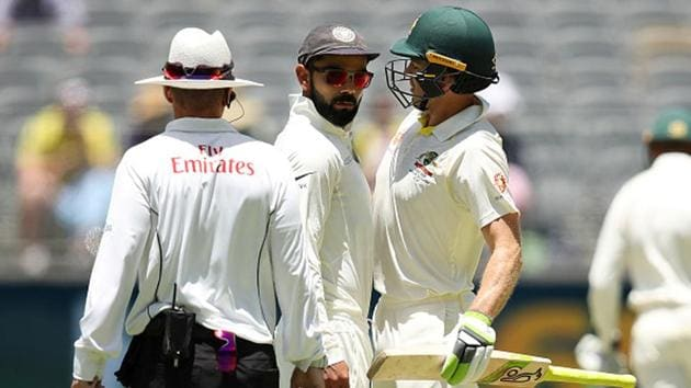 Virat Kohli and Tim Paine bump into each other.(Getty Images)