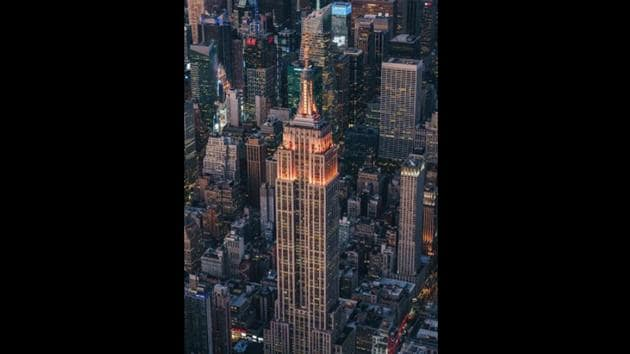 The iconic New York city destination Empire State Building was lit up in orange to commemorate Diwali.(Instagram/@empirestatebldg)