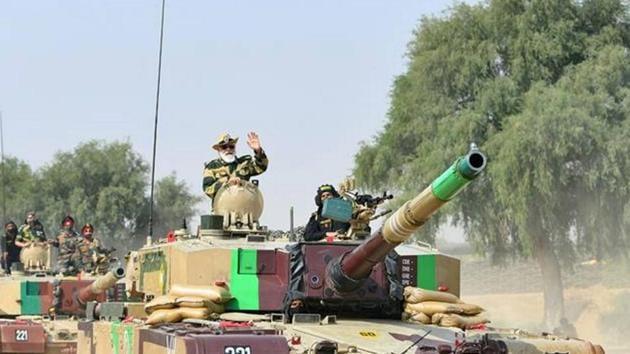 Prime Minister Narendra Modi rides in an Army tank at Longewala in Jaisalmer, Saturday.(PTI)
