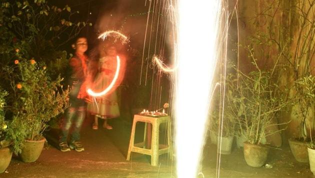 Revelers light sparklers in Ranchi.(Chandan Paul/HT PHOTO)