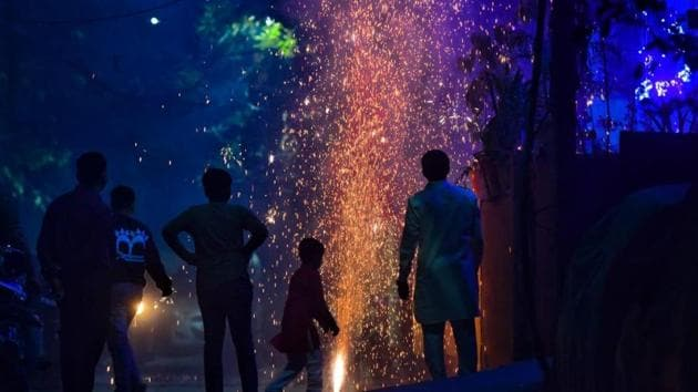 People bursting crackers in the National Capital Region on Diwali despite a ban on fireworks leading to rising pollution levels.(SANCHIT KHANNA/HT PHOTO.)