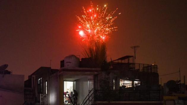 Fireworks set off in Safdarjung Enclave during Diwali celebrations in New Delhi on November 14. The pandemic also upended some of the celebrations in India, particularly in New Delhi, which has seen a renewed spike in coronavirus infections in recent weeks. Some people defiantly set off traditional firecrackers in Delhi despite a ban imposed because of sky-high pollution levels. (Amal KS / HT Photo)