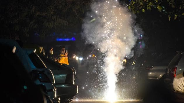 People bursting crackers at Patel Nagar in New Delhi on November 14. The use of firecrackers had been restricted in several states this year due to concerns over pollution and Covid-19. The link between air pollution and worsening Covid-19 cases remains mostly theoretical at the moment. But several researchers have said that dirty air should also be considered a key element in coronavirus outbreaks. (Sanchit Khanna / HT Photo)