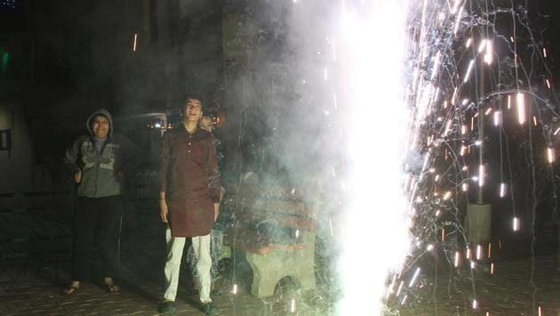 People burst crackers at Phase-XI in Mohali on Diwali. Unlike Chandigarh, fireworks were allowed here from 8pm to 10pm.(Gurminder Singh/HT)