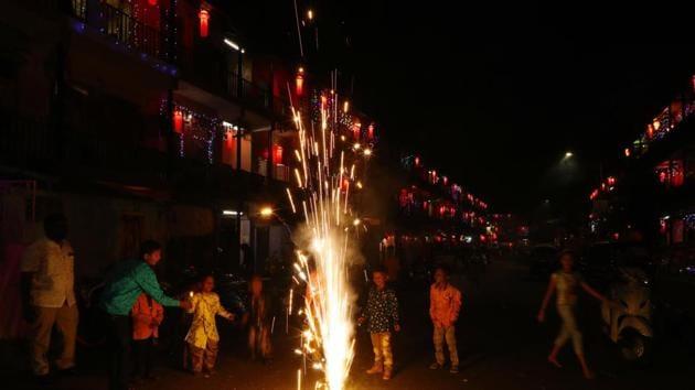 Children celebrate Diwali with crackers at housing society near Dandekar bridge on Saturday in Pune, India.(Photo by Rahul Raut/HT PHOTO)