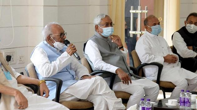 Bihar Chief Minister and Janata Dal United president Nitish Kumar with party state president Vashist Narayan Singh during the JD-U Legislature party meeting in Patna on Sunday.(ANI PHOTO.)