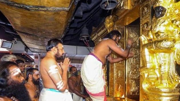 Priests perform rituals at the Sabarimala temple in Pathanamthitta district of Kerala.(PTI Photo)