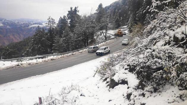 Kufri and Narkanda in the upper reaches of Shimla district received the season's first snowfall on Monday.(HT Photo)