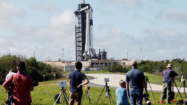 Photographers set up remote cameras before the launch of NASA's first operational commercial crew mission at Kennedy Space Center in Cape Canaveral, Florida on November 13. According to NASA officials, an air leak caused an unexpected drop in capsule pressure less than two hours before launch, Reuters reported. (Thom Baur / REUTERS)