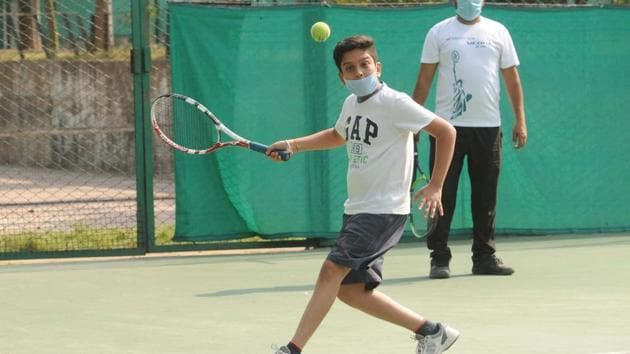 Player Evaar Kumar gets a session undergoing after Chandigarh Lawn Tennis Association (CLTA), sector 10, opened for training after nearly two months during nationwide locked down due to Coronavirus in Chandigarh.