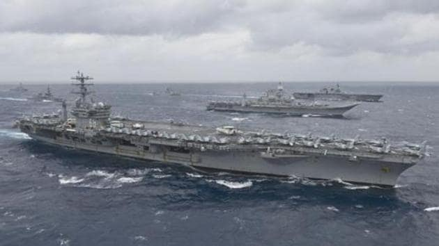 US aircraft carrier USS Nimitz will participate in the naval drills with Indian aircraft carrier Vikramaditya along with aircraft carriers from Australia and Japan in the high intensity naval operations over four days.(AFP Photo/File)