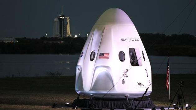A full-size model of the Crew-1 spacecraft module sits near the launch pad as a SpaceX Falcon 9 rocket is seen at launch complex 39A in the background at the Kennedy Space Center in Florida on November 15. SpaceX's newly designed Crew Dragon capsule, which the crew has dubbed Resilience, lifted off atop a SpaceX Falcon 9 rocket at 7:27 p.m. eastern time (0027 GMT on November 15), Reuters reported. (Gregg Newton / AFP)