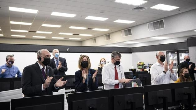 "NASA and SpaceX managers applaud after the launch of a SpaceX Falcon 9 rocket carrying the Crew Dragon spacecraft, at Firing Room 4 of the Launch Control centre at NASA's Kennedy Space Center in Cape Canaveral, Florida on November 15. NASA is calling the flight its first ""operational"" mission for a rocket and crew-vehicle system that was 10 years in the making."