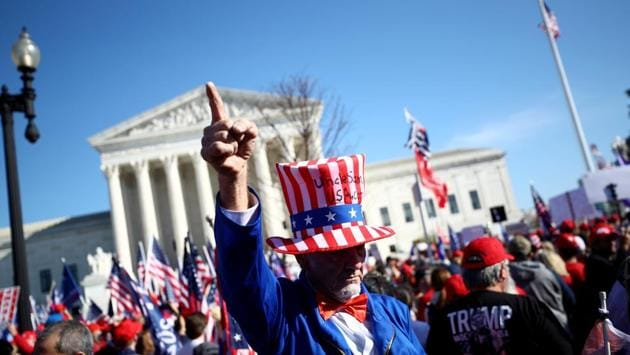 """Supporters of US President Donald Trump participate in a """"Stop the Steal"""" protest near the Supreme Court building, after the presidential election was called for Democratic candidate Joe Biden, in Washington, D.C., on November 14. Several thousand Trump supporters marched to the Supreme Court and were met with counter demonstrators. Nighttime clashes eventually resulted in at least one stabbing and more than 20 arrests, AP reported. (Hannah McKay / REUTERS)"""