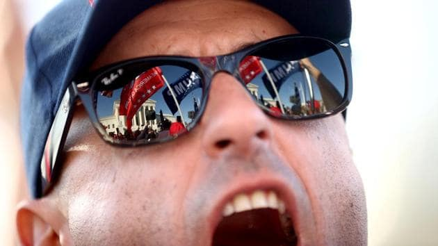 """A Trump supporter participates in a """"Stop the Steal"""" protest in Washington, D.C., on November 14. Cries of """"Stop the Steal"""" and """"Count Every Vote"""" rang out despite a lack of evidence of voter fraud or other problems that could reverse the result. (Hannah McKay / REUTERS)"""