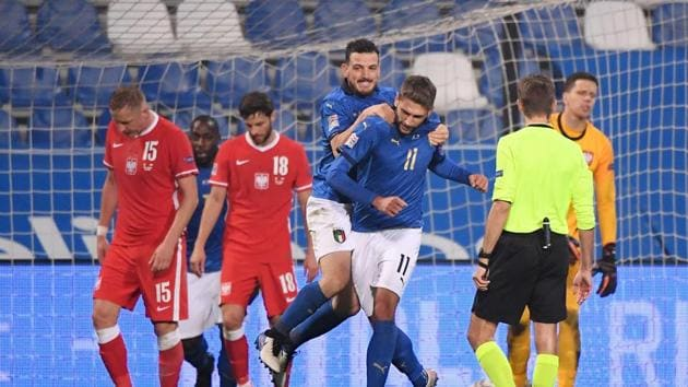 Italy's Domenico Berardi celebrates scoring their second goal.(REUTERS)