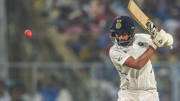 Indian batsman Cheteshwar Pujara plays a shot during the 1st pink-ball day/night cricket test match between India and Bangladesh.(PTI)