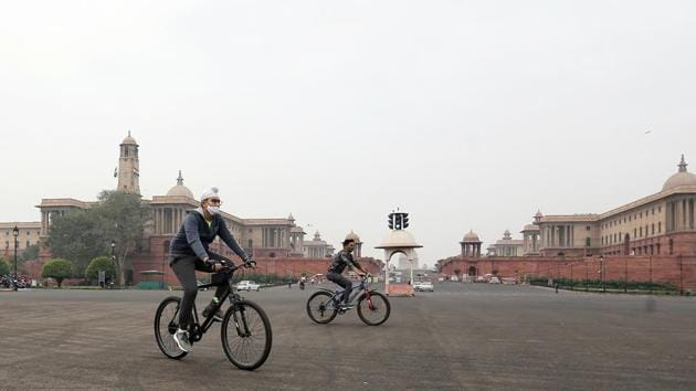 Cyclists ride bicycles near the Secretariat buildings in New Delhi on November 16. In the last week, Delhi has recorded an average of 7,341 cases every day, compared to 4,174 during its second wave of infections in September and 3,446 during the first wave in June, HT reported. (ANI)