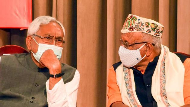 Bihar Chief Minister Nitish Kumar and Deputy Chief Minister Tarkishore Prasad during the oath-taking ceremony at Raj Bhawan in Patna on Monday.(PTI)