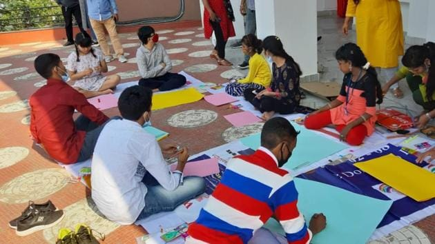 Children taking part in a poster-making initiative during their stay in Guwahati to prepare a manifesto.(Utpal Parashar/HT PHOTO)