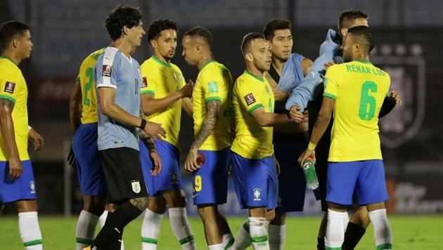 Players shake hands after the match between Brazil and Uruguay.(Reuters)