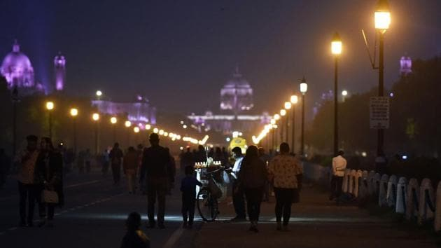 """People out in the evening on Rajpath with Rashtrapati Bhawan visible in the distance on November 16. The AQI is headed for another improvement and into the """"moderate"""" category by November 19, V K Soni told PTI. (Sanjeev Verma / HT Photo)"""