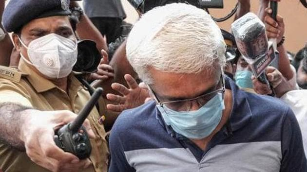 Suspended IAS officer M Sivasankar being taken into custody by Enforcement Directorate (ED) for questioning in connection to the Kerala gold smuggling case, in Kochi.(PTI)