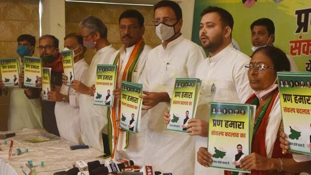Tejashwi Yadav and other Mahagathbandhan leaders during the release of their manifesto ahead of Bihar assembly election in Patna, in October.(HT Photo)