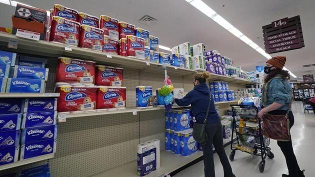 A woman buys toilet paper at a market in Mount Lebanon, Pa, on Tuesday.(AP Photo)