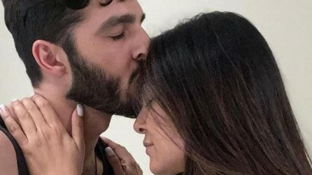 Rohman Shawl plants a kiss on Sushmita Sen's forehead.