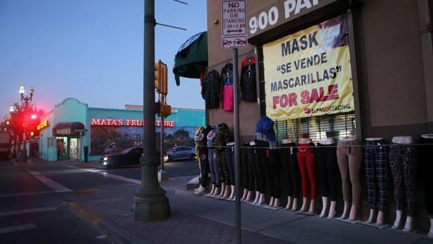 A shop advertises masks for sale in English and Spanish in El Paso on November 17. Daily infections have risen nationwide more than 80% over the past two weeks. The surge is leading governors and mayors across the US to grudgingly issue mask mandates, limit the size of gatherings ahead of Thanksgiving, and reinforce curbs on stores and other businesses. (Mario Tama / Getty Images / AFP)