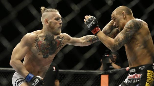 In this Sept. 27, 2014, file photo, Conor McGregor, left, and Dustin Poirier, exchange hits during their mixed martial arts bout in Las Vegas.(AP)