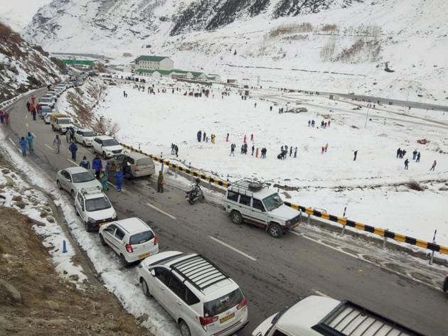 Tourists visit snow-covered fields after snowfall, near Atal Tunnel in Sissu, Lahaul-Spiti on Thursday, November 19.(PTI)