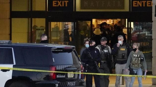FBI officials and police stand outside the Mayfair Mall after a shooting.(AP)