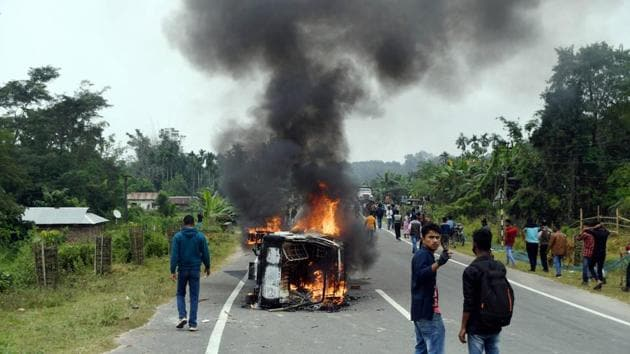A vehicle in flames during a protest by the Joint Movement Committee (JMC) against the resettlement of displaced Bru migrants in Kanchanpur sub-division, at Panisagar in North Tripura district.(PTI)