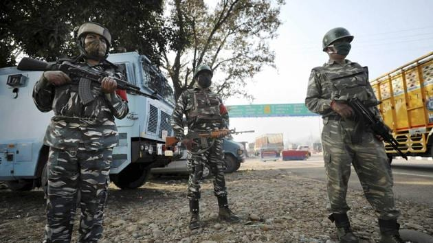 Central Reserve Police Force  (CRPF) personnel stand guard at Jammu & Kashmir National Highway after  an encounter at Ban Toll Plaza in Nagrota, in Jammu district.(PTI)