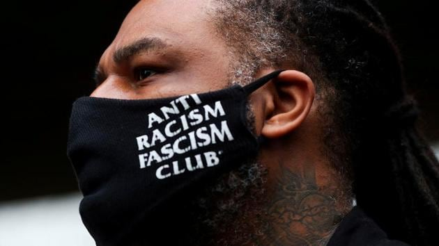 "A demonstrator's face mask reads ""Anti racism fascism club"" during a protest march in Sao Paulo on November 20. The video clip from the supermarket quickly went viral on social media and triggered the first round of demonstrations on November 20 as the country marked Black Consciousness Day. (Amanda Perobelli / REUTERS)"