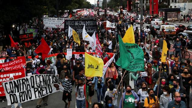 Demonstrators march in Sao Paulo on November 20. 55 percent of Brazil's population of 212 million identifies as black or mixed-race, AFP reported. (Amanda Perobelli / REUTERS)