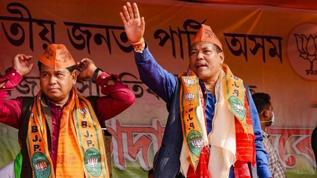 Former Bodoland People Front (BPF) MLA Emmanuel Mushahary and former BPF MP Biswajit Daimary greets supporters after formally joining BJP, ahead of the Bodoland Territorial Region (BTR) Election 2020, at Kumarikata in Assam's Baksa district on Sunday.(PTI)