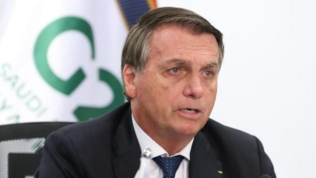 "Brazilian President Jair Bolsonaro once again downplayed structural racism in Brazil while speaking at the G20 summit via video conference from Planalto Palace in Brasilia on November 21. Bolsonaro condemned ""those who want to sow conflict and discord"" by trying to ""import"" tensions into the country ""that are not part of its history,"" AFP reported. (Marcos Correa / Brazilian Presidency / AFP)"