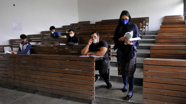 Only a few students in class at the Post Graduate Government College in Sector 46, Chandigarh, on Monday. Most colleges that reopened in the city reported thin attendance.(Keshav Singh/Hindustan Times)