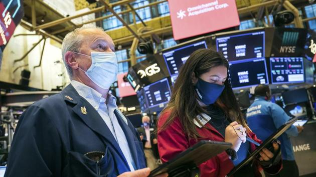 Shares and oil prices rose on Monday while the dollar fell as investors pinned hopes for economic revival on coronavirus vaccines, even as the world contended with surging case numbers and delays to fresh US stimulus.(AP)