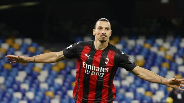 Soccer Football - Serie A - Napoli v AC Milan - Stadio San Paolo, Naples, Italy - November 22, 2020 AC Milan's Zlatan Ibrahimovic celebrates scoring their first goal while wearing red face paint to raise awareness of domestic violence against women REUTERS/Ciro De Luca(REUTERS)