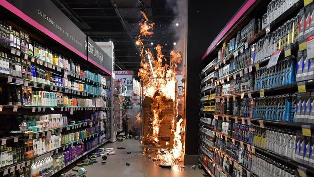 Products set on fire by protesters at a supermarket Carrefour on Black Consciousness Day during a protest against racism and the death of a black man who was beaten to death by white security agents in a supermarket of the same chain, in Sao Paulo on November 20. (Nelson Almeida / AFP)
