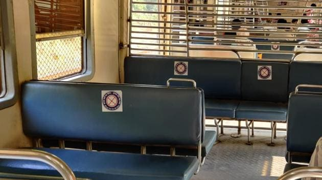 Stickers remind people not to sit on particular seats to ensure social distancing on Mumbai locals.(Photo:Sourced)