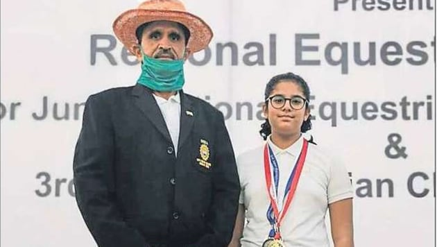 Padmini Rao, who won multiple medals in the horse jumping competition, with her teacher.(HT)