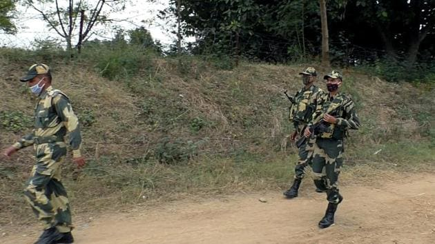 BSF personnel patrolling near the border in Samba on Tuesday.(ANI Photo)