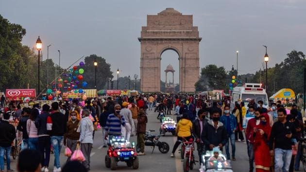 Visitors at India Gate in New Delhi on November 22. Delhi is experiencing a colder than normal winter because of global factors such as La Nina, a global weather pattern linked to low minimum temperatures in northwest India, HT reported. (Manvender Vashist / PTI )