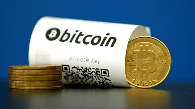 A Bitcoin (virtual currency) paper wallet with QR codes and a coin are seen in an illustration picture.(REUTERS)
