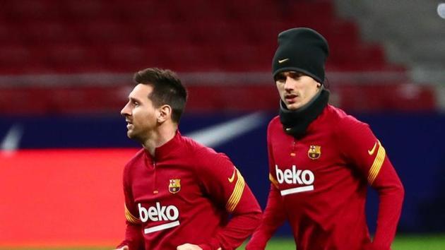 Soccer Football - La Liga Santander - Atletico Madrid v FC Barcelona - Wanda Metropolitano, Madrid, Spain - November 21, 2020 Barcelona's Lionel Messi and Antoine Griezmann during the warm up before the match REUTERS/Sergio Perez(REUTERS)